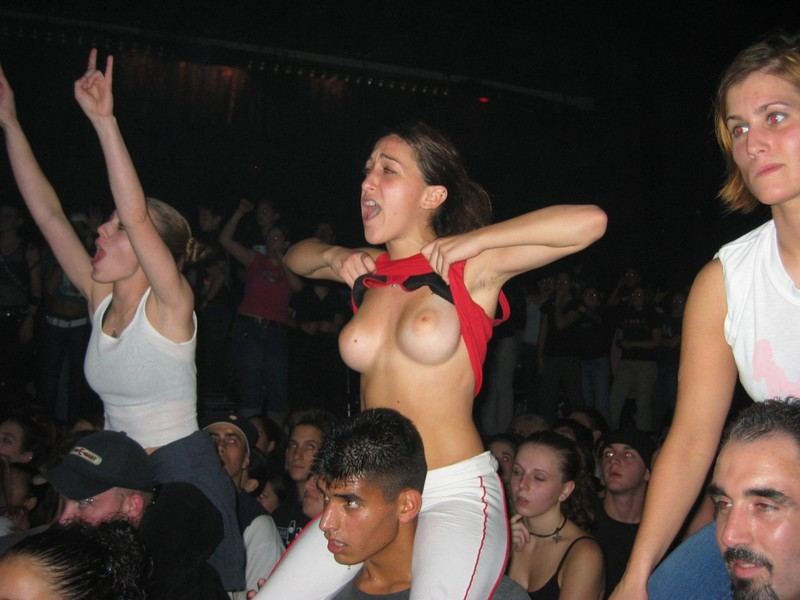 Girl flashing tits at concert